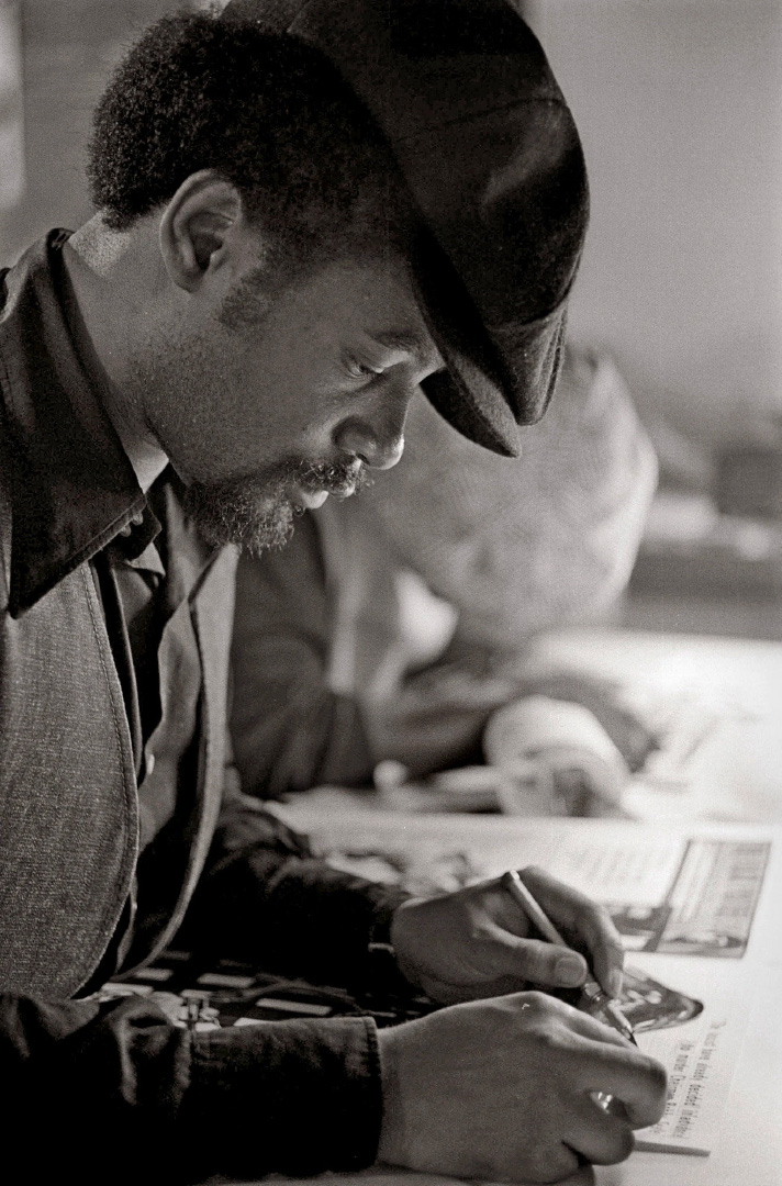 Emory Douglas at work on The Black Panther, 1970. Photo: Stephen Shames. Reproduced from Black Panther: The Revolutionary Art of Emory Douglas.