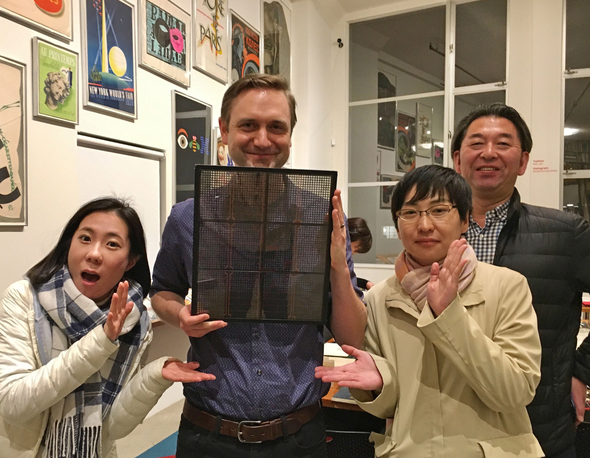 Min-Young Kim, Akira Himei, and Chiaki Nakamori of Morisawa present the phototype plate donation to the Archive's Stephen Coles in November 2017.