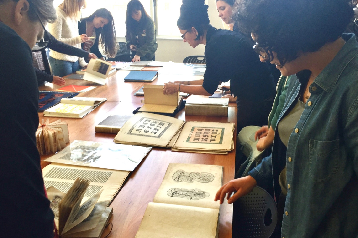 students browse in the Letterform Archive reading room